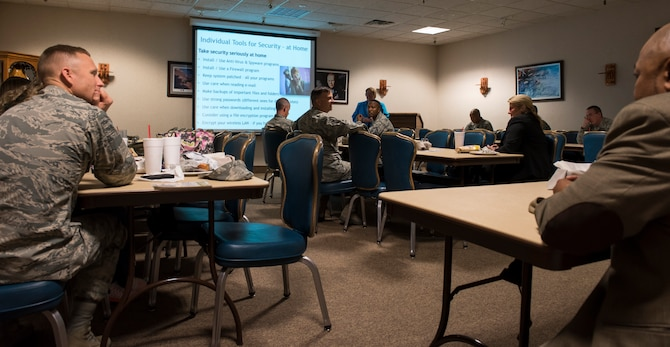 Terry Pobst-Martin, 366th Fighter Wing chief of information security, briefs airmen Oct. 20, 2015 at Mountain Home Air Force Base, Idaho. To celebrate Cyber Security Month, the base hosted Cyber Security Week, open to airmen and their families, to teach safer computer use. (U.S. Air Force photo by Senior Airman Jeremy L. Mosier/ RELEASED)