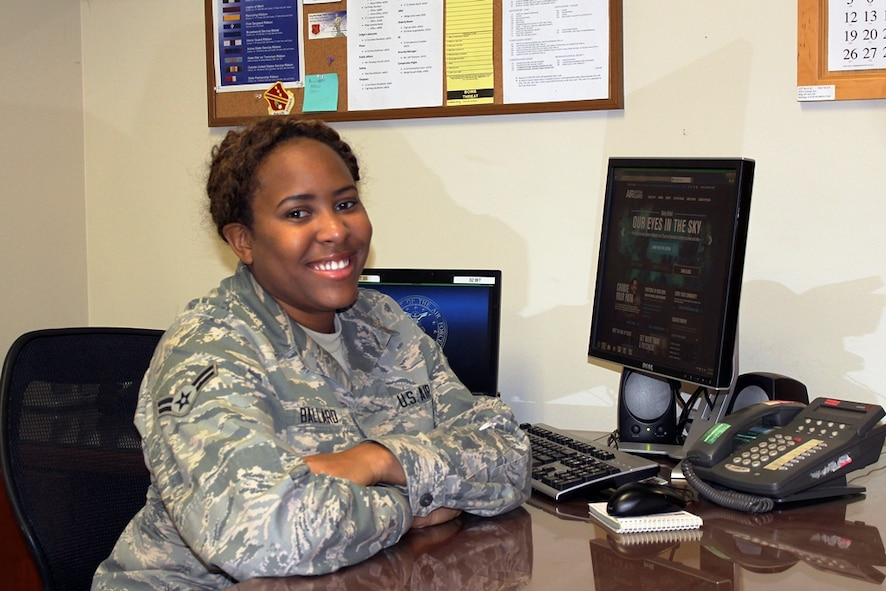 """151027-Z-VA676-072 -- Airman 1st Class Kyra Ballard sits in the orderly room of the 127th Wing headquarters at Selfridge Air National Guard Base, Oct. 27, 2015. Ballard said she enlisted in the Air National Guard to create an opportunity for herself. """"Joining the Air Force is probably the best decision I have made in my life, so far,"""" she said. (U.S. Air National Guard photo by Tech. Sgt. Dan Heaton)"""