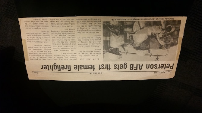 PETERSON AIR FORCE BASE, Colo. – A newspaper clipping from April 12, 1979 memorializes Peterson AFB's first female firefighter, Deputy Chief Cindy Litteral. Litteral began her career as an enlisted Airman and retires from her civil service career as one of only 30 female deputy fire chiefs in the country. (U.S. Air Force photo by Lori O'Donley)