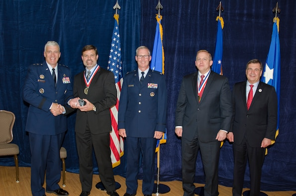 Dr. Robert Murphey, the Munition Airframe Guidance Navigation and Controls Core Technical Competency Lead for the Munitions Directorate, was inducted into the AFRL Fellows Program on October 22, at the 2015 Fellows Ceremony, which took place at the Wright-Patterson Club. Pictured from left to right are AFRL Commander Maj. Gen. Thomas Masiello, Dr. Robert Murphey, Col. Scott Martin, AFRL Chief Technologist Dr. Morley Stone and Air Force Chief Scientist Dr. Greg Zacharias. (U.S. Air Force photo/Michael Huber)
