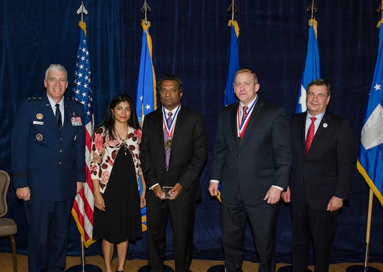 Dr. Reji John, the Principal Materials Research Engineer for the AFRL Materials and Manufacturing Directorate, was inducted into the AFRL Fellows Program on October 22, at the 2015 Fellows Ceremony, which took place at the Wright-Patterson Club. Pictured from left to right are AFRL Commander Maj. Gen. Thomas Masiello, Mrs. John, Dr. Reji John, AFRL Chief Technologist Dr. Morley Stone and Air Force Chief Scientist Dr. Greg Zacharias. (U.S. Air Force photo/Michael Huber)