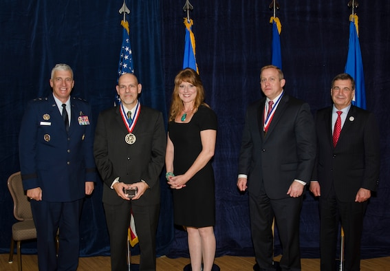Dr. Raymond Kolonay, the Multidisciplinary Science and Technology Center for the Aerospace Systems Directorate, was inducted into the AFRL Fellows Program on October 22, at the 2015 Fellows Ceremony, which took place at the Wright-Patterson Club. Pictured from left to right are AFRL Commander Maj. Gen. Thomas Masiello, Dr. Raymond Kolonay, Mrs. Kolonay, AFRL Chief Technologist Dr. Morley Stone and Air Force Chief Scientist Dr. Greg Zacharias. (U.S. Air Force photo/Michael Huber)