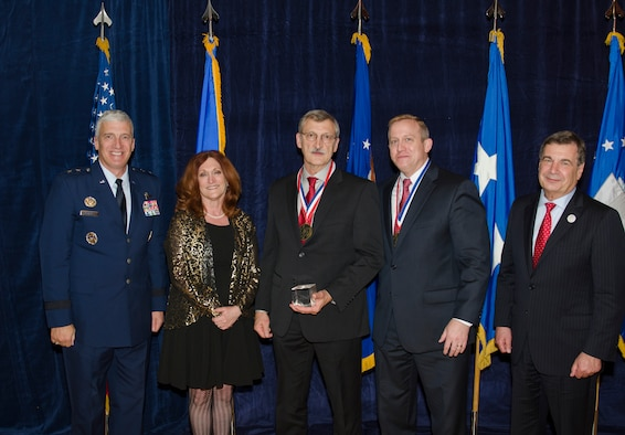Mr. Byron Edmonds, a Materials Research Engineer for the Materials and Manufacturing Directorate,  was inducted into the AFRL Fellows Program on October 22, at the 2015 Fellows Ceremony, which took place at the Wright-Patterson Club. Pictured from left to right are AFRL Commander Maj. Gen. Thomas Masiello, Mrs. Edmonds, Mr. Byron Edmonds, AFRL Chief Technologist Dr. Morley Stone, and Air Force Chief Scientist Dr. Greg Zacharias. (U.S. Air Force photo/Michael Huber)
