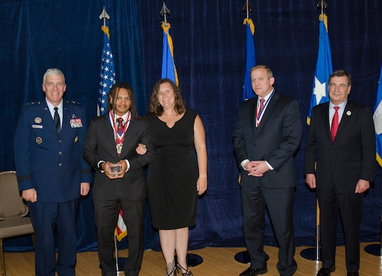 Dr. Moriba Jah, Principal Investigator for the Directed Energy Directorate, was inducted into the AFRL Fellows Program on October 22, at the 2015 Fellows Ceremony, which took place at the Wright-Patterson Club. Pictured from left to right are AFRL Commander Maj. Gen. Thomas Masiello, Dr. Moriba Jah, Mrs. Jah, AFRL Chief Technologist Dr. Morley Stone and Air Force Chief Scientist Dr. Greg Zacharias. (U.S. Air Force photo/Michael Huber)