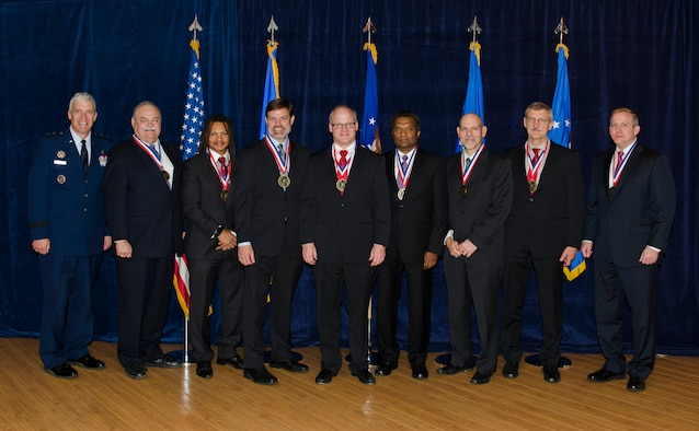 The most outstanding researchers representing the top 0.2 percent of AFRL technical professionals stand for a photo after being formally inducted into the prestigious ranks of the Fellows Program on October 22. Pictured from left to right are AFRL Commander Maj. Gen. Thomas Masiello, Mr. Kevin Slimak, Dr. Moriba Jah, Dr. Robert Murphey, Dr. Mark Linderman, Dr. Reji John, Dr. Raymond Kolonay, Mr. Byron Edmonds, and AFRL Chief Technologist Dr. Morley Stone. (U.S. Air Force photo/Michael Huber)