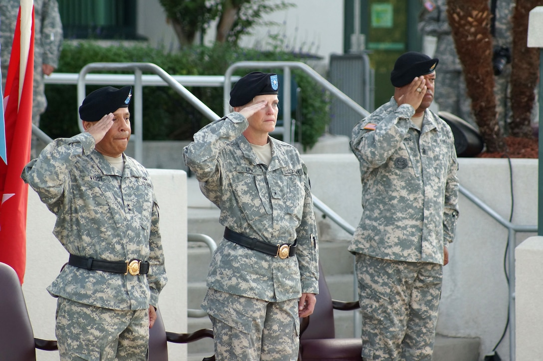 (From left to right) Maj. Gen. Luis R. Visot, the U.S. Army Reserve Command chief of staff, Maj. Gen. Mary E. Link, incoming commanding general of the Army Reserve Medical Command, and Command Sgt. Maj. Marlo V. Cross Jr, the incoming ARMEDCOM command sergeant major, salute the U.S. flag during the ARMEDCOM change of command ceremony held Sept. 26, 2015, at the C.W. Bill Young Armed Forces Reserve Center in Pinellas Park, Fla. Visot hosted the ceremony, in which Link and Cross assumed command and responsibility respectively from the outgoing command team of Maj. Gen. Bryan R. Kelly and Command Sgt. Maj. Harold P. Estabrooks.