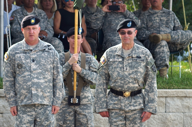 The outgoing command team of the Army Reserve Medical Command, Command Sgt. Maj. Harold P. Estabrooks and Maj. Gen. Bryan R. Kelly, case the command general's individual flag signifying the end of his command. Estabrooks is scheduled for a tour of duty in Italy and Kelly is retiring after 26 years of dedicated service to the U.S. Army Reserve. He plans to spend more time with his family and continue his civilian career as a clinical psychologist near his hometown of East Sandwich, Mass.