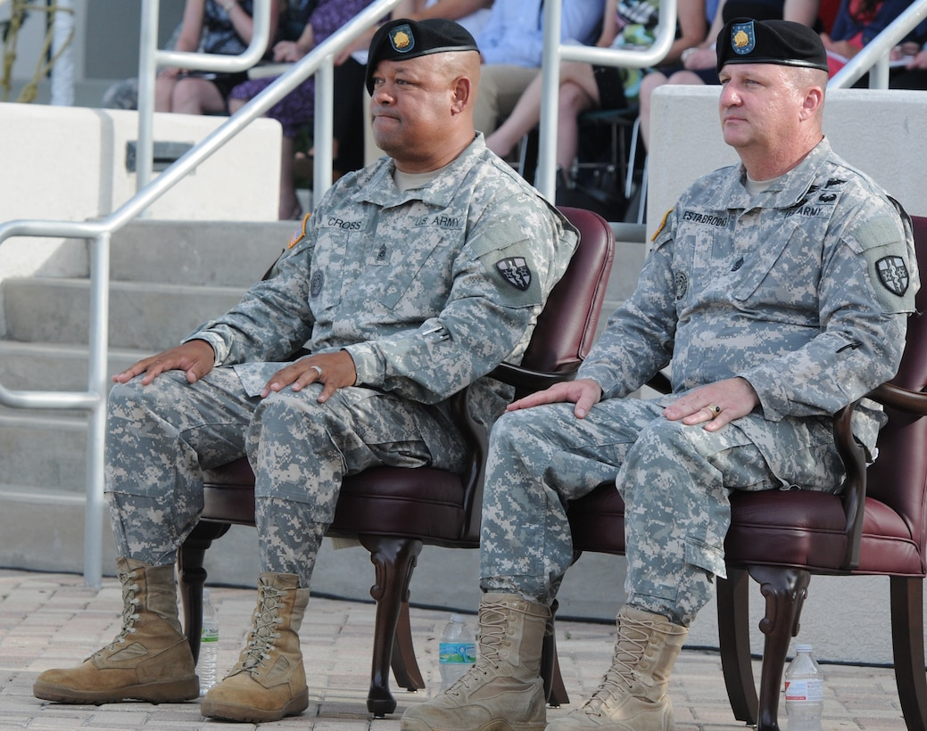 Command Sgt. Maj. Marlo V. Cross the incoming command sergeant major of the Army Reserve Medical Command, sits next to Command Sgt. Maj. Harold P. Estabrooks, the outgoing ARMEDCOM command sergeant major during the unit's change of command and change of responsibility ceremony held Sept. 26, 2015, at the C.W. Bill Young Armed Forces Reserve Center. (U.S. Army photo Staff Sgt. Andrea Merritt/Released)