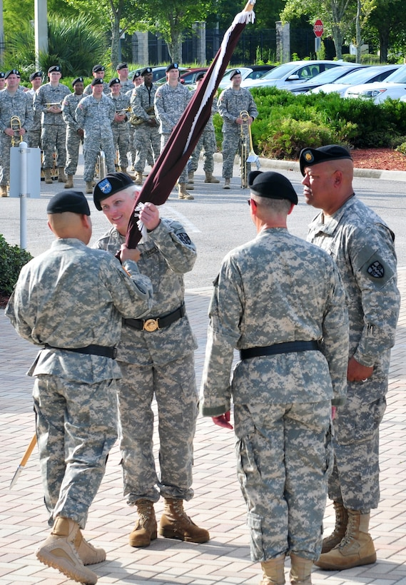 Maj. Gen. Mary E. Link, incoming commanding general of the Army Reserve Medical Command receives the guidon from Maj. Gen. Luis R. Visot, the U.S. Army Reserve Command chief of staff, during the ARMEDCOM change of command ceremony held Sept. 26, 2015 at the C.W. Bill Young Armed Forces Reserve Center in Pinellas Park, Fla. The transfer of the flag from Visot to Link signifies entrusting her with the authority and responsibility of command. Link served as the deputy commanding general for ARMEDCOM for three years prior to her promotion and subsequent assignment as the commanding general of ARMEDCOM.