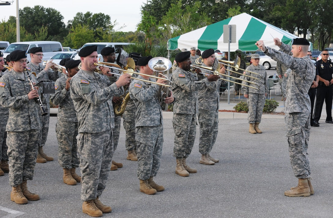 The 313th Army Reserve Band out of Birmingham, Ala., plays the Army Song during the Army Reserve Medical Command Change of Command Ceremony held Sept. 26, 2015, at the C.W. Bill Young Armed Forces Reserve Center in Pinellas Park, Fla. During the ceremony, the incoming command team Maj. Gen. Mary E. Link and Command Sgt. Maj. Marlo V. Cross, assumed command and responsibility respectively from Maj. Gen. Bryan R. Kelly and Command Sgt. Maj. Harold P. Estabrooks, the outgoing command team.