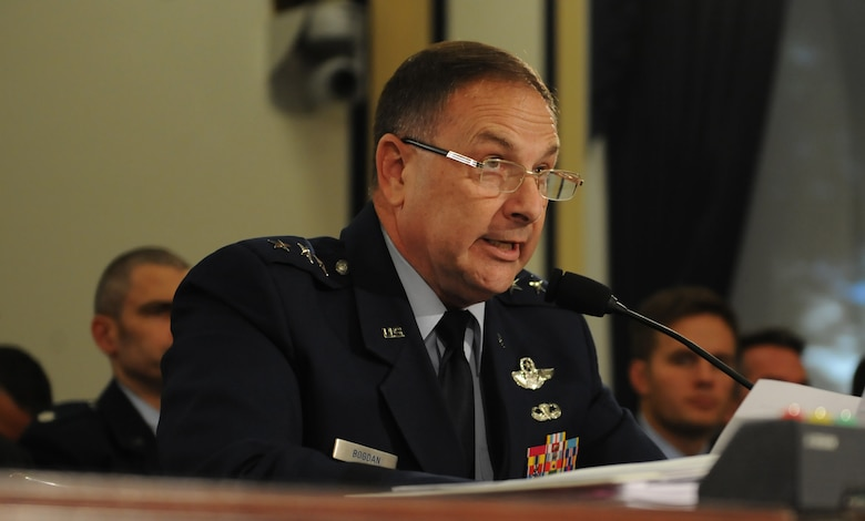 Lt. Gen. Christopher Bogdan, the F-35 program executive officer, testifies before the House Armed Services Subcommittee on Tactical Air and Land Forces Oct. 21 on Capitol Hill. Overall, the program has flown more than 42,000 hours, to include the international jets and the U.S. service-specific variations. (U.S. Air Force photo/Senior Airman Hailey Haux)