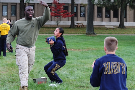 Sgt. Darrell D. Buckley, canvassing recruiter with Marine Corps Recruiting Substation Trenton, motivates a team of Naval Sea Cadets during a leadership seminar with the United States Naval Sea Cadet Corps John T. Dempster, Jr. Division, in Lawrenceville, N.J., Oct. 18, 2015. The Marines spent several hours with the Sea Cadets covering the significance of leadership, working together, being unselfish, and how to overcome adversity.