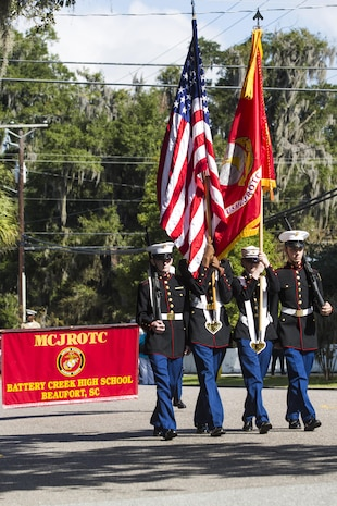 Students with the Marine Corps Junior Reserve Officer Training Corps march during the Parris Island Centennial Parade in Port Royal Oct. 24. The parade is one of many celebrations and events that have occurred throughout the area commemorating the depot's 100th year of training Marines.