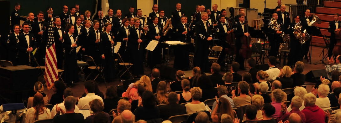 The USAF Concert Band and Singing Sergeants perform for a packed auditorium at Amsterdam High School, in Amsterdam, NY. This performance was part of the fall 2015 Concert Band and Singing Sergeants tour on October 22. (U.S. Air Force photo/released)