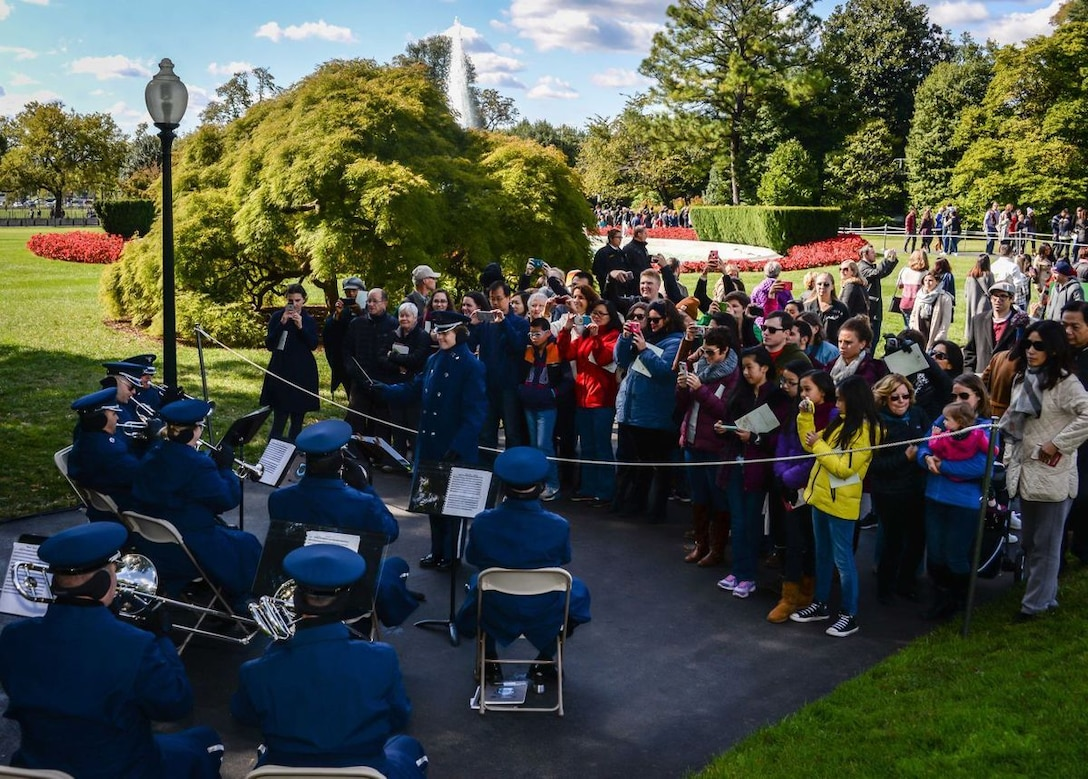 The Ceremonial Brass entertains visitors at the Fall 2015 White House Garden Tour Oct. 18, under the direction of Captain Haley Armstrong. The band played to crowds of hundreds of people who were both waiting in line and walking the White House grounds. (Courtesy photo by Scott Pauley)