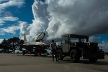 BEJA AIR BASE, Portugal – Members of the 52nd Maintenance Group prepare to tow an F-16 Fighting Falcon fighter aircraft, assigned to the 480th Fighter Squadron at Spangdahlem Air Base, Germany, during Trident Juncture 2015 at Beja Air Base, Portugal, Oct. 27, 2015. More than 100 Airmen assigned to the 52nd Maintenance Group deployed to Portugal in support of Trident Juncture 2015, the largest NATO exercise conducted in the past 20 years. (U.S. Air Force photo by Airman 1st Class Luke Kitterman/Released)