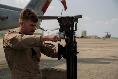 Sgt. Brandon Jackson assembles a Dillon M134 Gatling Gun before departing for a mission to recover a simulated downed aircraft, Oct. 28, 2015, during Blue Chromite 16, at Marine Corps Air Station Futenma, Okinawa, Japan. The mission, which included assets from Marine Air Group 36, also included members of 3rd Law Enforcement Battalion, who recovered personnel with assistance of military working dogs. Blue Chromite is a large-scale amphibious exercise that draws primarily from III Marine Expeditionary Force's training resources on Okinawa. The location of the training allows participating units to maintain a forward-deployed posture and eliminates the cost of traveling to train. Jackson is from Fort Collins, Colo., and a Bell UH-1Y Venom airframe mechanic with MAG 29, HMLA 269, 2nd Marine Aircraft Wing, II Marine Expeditionary Force, currently attached to 1st MAW, III MEF. (U.S. Marine Corps Photo by Cpl. Devon Tindle/Released)