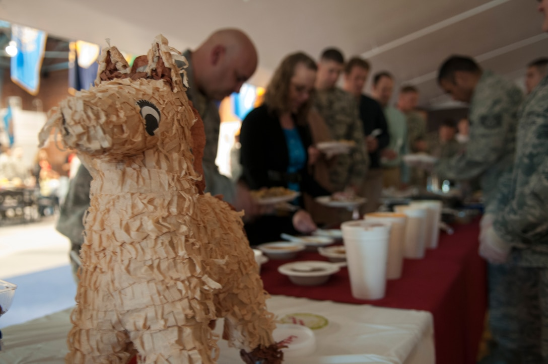 A piñata welcomes people as they line up for food in the Fall Hall Community Center, Oct. 27, 2015, during this year's National Hispanic Heritage Observance. Those in attendance were treated to a variety of Hispanic dishes as well as music in support of the culture. (U.S. Air Force photo by Airman 1st Class Malcolm Mayfield)