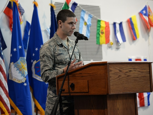 Airman 1st Class Richard Sanchez, 90th Missile Maintenance Squadron technician, speaks about his girlfriend's grandfather's experiences during the time of the Cuban Revolution in the Fall Hall Community Center, Oct. 27, 2015, during this year's National Hispanic Heritage Observance. Sanchez read inserts pulled directly from a journal written during the time. (U.S. Air Force photo by Airman 1st Class Malcolm Mayfield)