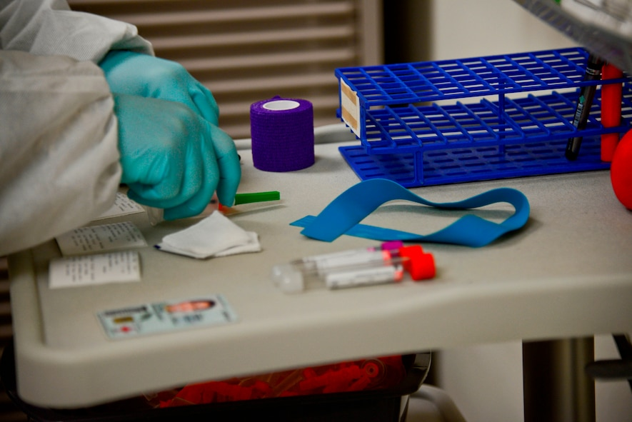 A laboratory technician verifies a patient's identification and prepares a needle and vials to draw blood in the 51st Medical Support Squadron laboratory at Osan Air Base, Republic of Korea, Oct. 21, 2015. Blood draws can be used for numerous reasons including HIV, drug, and pregnancy tests, check cholesterol, determine if someone is sick, or if they have a bacterial infection, and even if someone recently had a heart attack. (U.S. Air Force photo/Tech. Sgt. Travis Edwards)