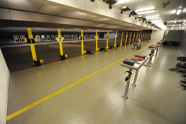 Ellsworth's combat arms range is an indoor facility used for firearms training at Ellsworth Air Force Base, S.D., Oct. 13, 2015. Personnel eligible for CA courses include deployers and those with duty qualification requirements, such as explosive ordnance disposal teams, security forces personnel and members of Air Force Office of Special Investigations. (U.S. Air Force photo by Airman Sadie Colbert/Released)