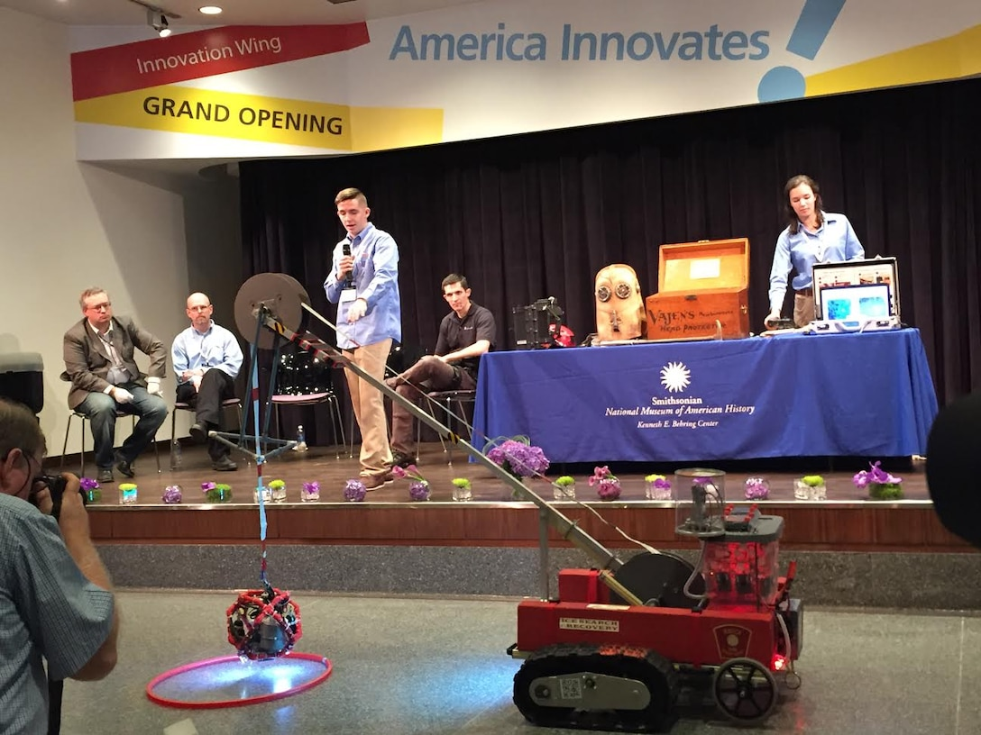 Airman 1st Class Ford Grundberg, 3rd Space Operations Squadron Defense Satellite Communications System satellite vehicle operator, presents the search and rescue robot he and his team invented at the Lemelson Foundation 20th anniversary Sept. 18, 2015, in the Smithsonian Museum of Natural History in Washington, D.C. Grundberg explained his presentation was the first opportunity he's ever had to speak in front of a crowd. (Courtesy Photo)