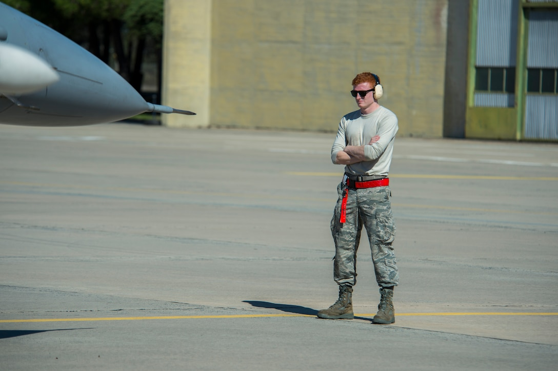 BEJA AIR BASE, Portugal – U.S. Air Force Senior Airman Daniel Brewer, 52nd Aircraft Maintenance Squadron weapons load crew member, conducts a pre-flight check on an F-16 Fighting Falcon fighter aircraft, assigned to the 480th Fighter Squadron at Spangdahlem Air Base, Germany, before it participates in Trident Juncture 2015 at Beja Air Base, Portugal, Oct. 22, 2015. More than 100 Airmen assigned to the 52nd Maintenance Group deployed to Portugal in support of Trident Juncture 2015, the largest NATO exercise conducted in the past 20 years. (U.S. Air Force photo by Airman 1st Class Luke Kitterman/Released)