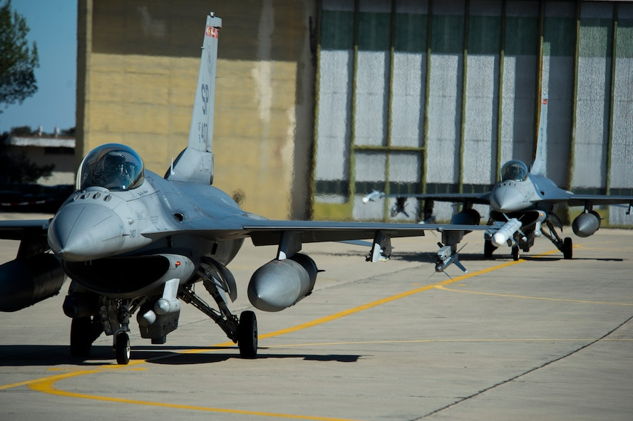 BEJA AIR BASE, Portugal – Two F-16 Fighting Falcon fighter aircraft, assigned to the 480th Fighter Squadron at Spangdahlem Air Base, Germany, taxi towards the runway before a mission at Exercise Trident Juncture 2015 at Beja Air Base, Portugal, Oct. 22, 2015. The 480th FS deployed five F-16s and approximately 130 Airmen to Beja in support of Trident Juncture 2015, the largest NATO exercise conducted in the past 20 years. (U.S. Air Force photo by Airman 1st Class Luke Kitterman/Released)
