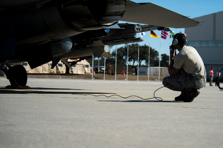 BEJA AIR BASE, Portugal – U.S. Air Force Staff Sgt. Christopher Pridgen, 52nd Aircraft Maintenance Squadron crew chief, conducts a pre-flight check on an F-16 Fighting Falcon fighter aircraft, assigned to the 480th Fighter Squadron at Spangdahlem Air Base, Germany, before it participates in Trident Juncture 2015 at Beja Air Base, Portugal, Oct. 22, 2015. More than 100 Airmen assigned to the 52nd Maintenance Group deployed to Portugal in support of Trident Juncture 2015, the largest NATO exercise conducted in the past 20 years. (U.S. Air Force photo illustration by Airman 1st Class Luke Kitterman/Released)