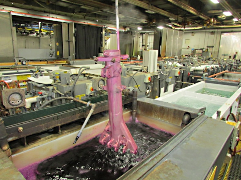 An F-15 outer piston is anodized and sealed with new potassium permanganate sealer at Ogden Air Logistics Complex.  AFRL researchers identified and tested this non-chromium sealer as a safer alternative to chromium-based products, and it is now fully incorporated into OO-ALC's coating process. (U.S. Air Force Photo)