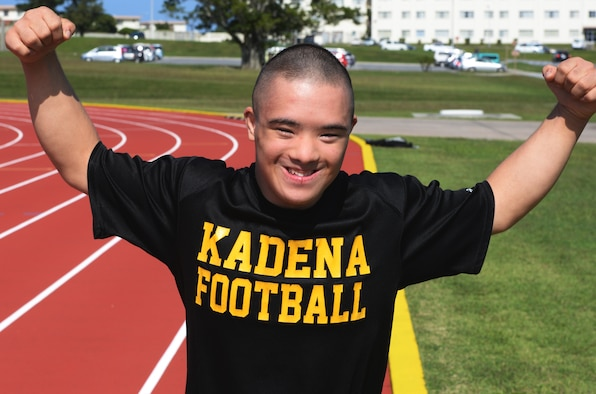 Ty Murdock, Kadena High School 12th grade student, is the honorary captain for his high school football team and competes annually at the Kadena Special Olympic games on Kadena Air Base. Murdock will go for gold again in the KSO after finishing in first place last year. He enjoys the applause and cheering from the crowd when he races in the competition. (U.S. Air Force photo by Senior Airman Omari Bernard)