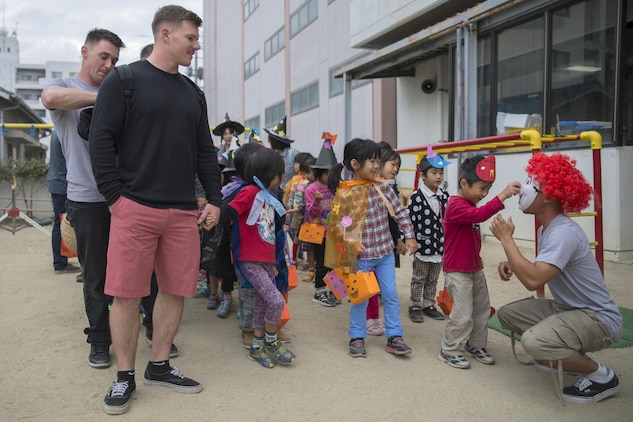 Service members stationed at Marine Corps Air Station Iwakuni, Japan, paired up with Japanese children from the Ekimae Hoikuen Pre-school before walking around town in Iwakuni City, Oct. 27, 2015. The community relations event, hosted by the Marine Memorial Chapel on the air station, gave service members the opportunity to interact with the Japanese youth and teach them about Halloween. Service members are afforded an opportunity to explore Iwakuni and experience the Japanese culture by volunteering for these events.
