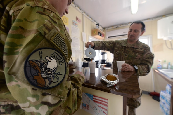 U.S. Air Force Col. Robert Epstein, Train, Advise, Assist Command – Air (TAAC-Air) director of staff, serves free coffee at the Gratitude Café Forward Operating Base Kabul, Afghanistan, Sept. 20, 2015. The Gratitude Café was started two years ago with the idea to set up a coffee house to serve the troops with a free cup of coffee every morning. (U.S. Air Force photo by Staff Sgt. Sandra Welch/released)