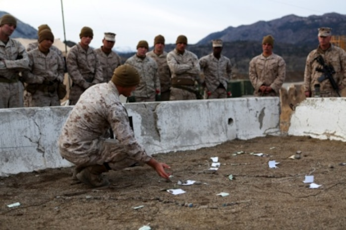 1st Lt. Tyler Sweet, combat engineer officer, Combat Logistics Battalion 11, 1st Marine Logistics Group, explains the route and plan for security patrols to be conducted by members of CLB-11's engineer platoon during Mountain Exercise 6-15 at Marine Corps Mountain Warfare Training Center, Bridgeport, Calif., Oct. 25, 2015. Engineer Platoon conducted two consecutive days of security patrols along a mountain trail to provide route reconnaissance, deter enemy forces and remove obstacles that would restrict friendly and civilian movement.