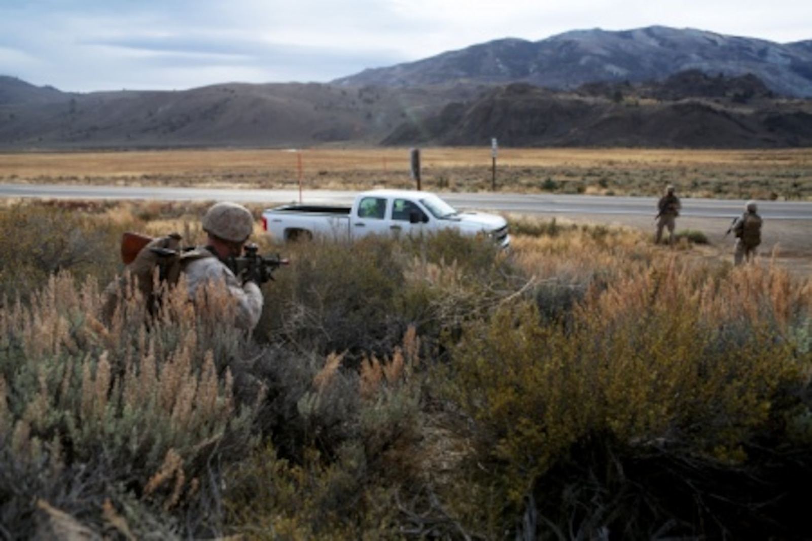 Marines from Engineer Platoon, Combat Logistics Battalion 11, 1st Marine Logistics Group, stop a potential threat during a security patrol in Mountain Exercise 6-15 at Marine Corps Mountain Warfare Training Center, Bridgeport, Calif., Oct. 25, 2015. Engineer Platoon conducted two consecutive days of security patrols along a mountain trail to provide route reconnaissance, deter enemy forces and remove obstacles that would restrict friendly and civilian movement.