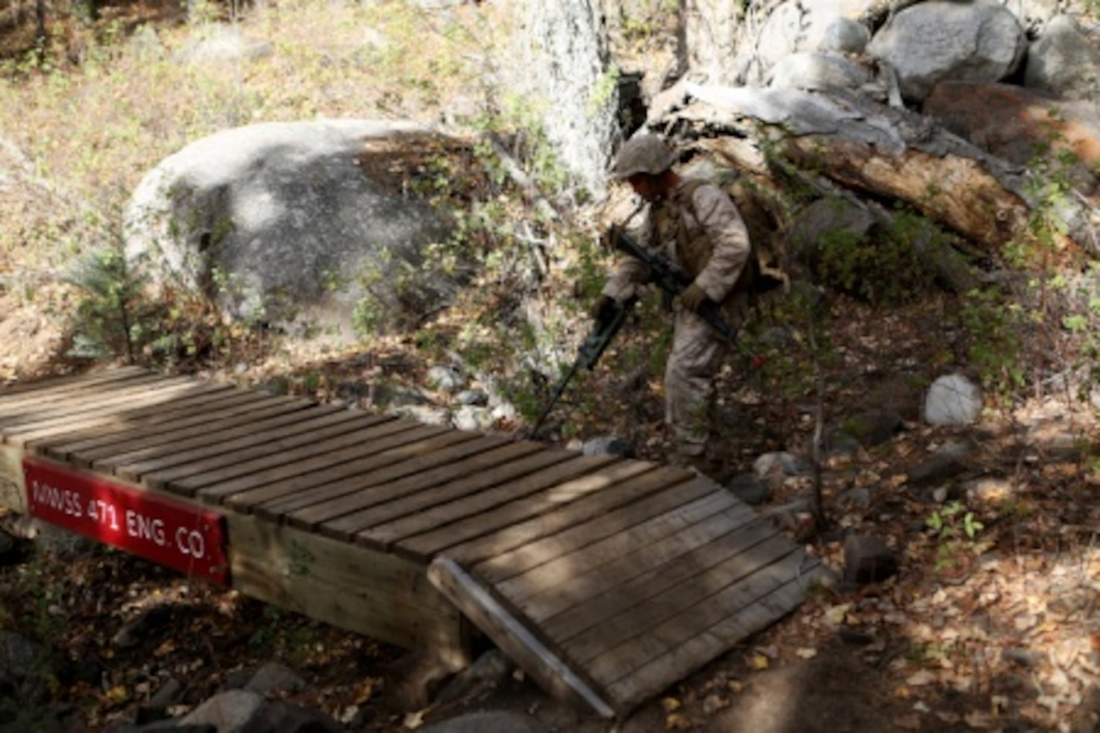 Cpl. Ben Hernandez, water purification specialist, Combat Logistics Battalion 11, 1st Marine Logistics Group, checks for potential improvised explosive devices or threats conducted by members of CLB-11's engineer platoon during Mountain Exercise 6-15 at Marine Corps Mountain Warfare Training Center, Bridgeport, Calif., Oct. 25, 2015. Engineer Platoon conducted two consecutive days of security patrols along a mountain trail to provide route reconnaissance, deter enemy forces and remove obstacles that would restrict friendly and civilian movement.