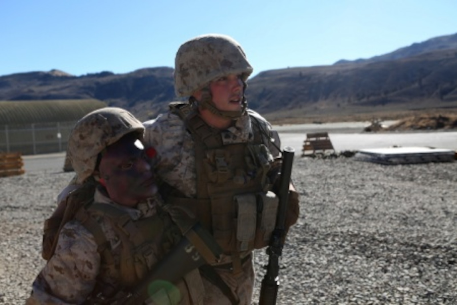 Cpl. James Negri, combat engineer, Combat Logistics Battalion 11, 1st Marine Logistics Group, helps a casualty get to safety after a simulated suicide bomber attack during Mountain Exercise 6-15 at Marine Corps Mountain Warfare Training Center, Bridgeport, Calif., Oct. 25, 2015. Engineer Platoon conducted two consecutive days of security patrols to ensure the safety of the base camp and was confronted with the challenge of a mass casualty event at the end of their patrol.
