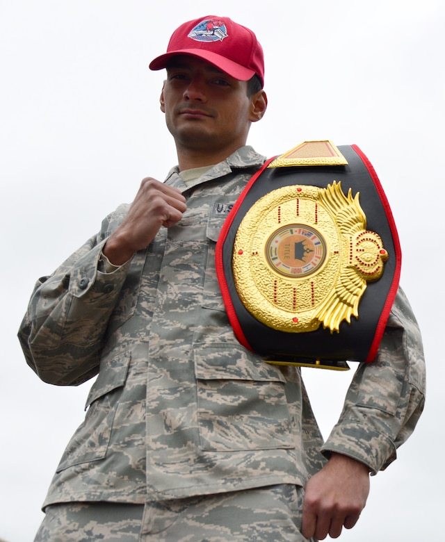 Senior Airman Mark Wirth, a 819th RED HORSE Squadron structural engineer, poses for a photo Oct. 27, 2015, at Malmstrom Air Force Base, Mont. Wirth holds the title for the 125-pound flyweight division for Fight Force, a group he fights for. (U.S. Air Force photo/Airman Daniel Brosam)