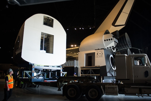 DAYTON, Ohio -- Restoration staff move the Space Shuttle Exhibit(CCT) into the new fourth building at the National Museum of the U.S. Air Force on Oct. 22, 2015. (U.S. Air Force photo)