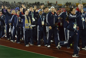 U.S. armed forces athletes wave to the crowd as they walk into the closing ceremony of the CISM World Games in the main stadium of the Korean Armed Forces Athletic Corps in MunGyeong, South Korea, Oct. 11, 2015.