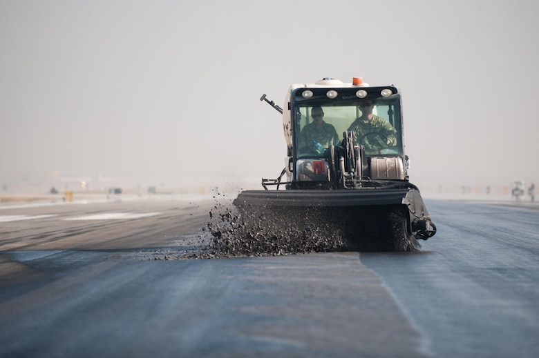 Airmen from the 577th Expeditionary Prime Base Engineer Emergency Force Squadron from Al Udeid Air Base, Qatar, remove rubber from the runway Oct. 22, 2015, at Bagram Air Field, Afghanistan. Foam and biodegradable solvents are used to strip the rubber left behind by the aircraft that land or take off from Bagram in support of the Operation Freedom's Sentinel and NATO's Resolute Support missions. (U.S. Air Force photo/Tech. Sgt. Joseph Swafford)
