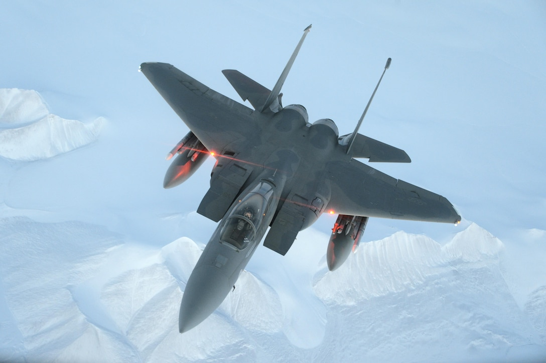 An F-15C Eagle from the 144th Fighter Wing flies above the High Arctic Oct. 22, 2015. From Oct. 15-26, 2015, approximately 700 members from the Canadian Armed Forces and the U.S. Air Force, Navy, and Air National Guard deployed to Iqaluit, Nunavut, and 5 Wing Goose Bay, Newfoundland and Labrador, for Exercise Vigilant Shield 16. (U.S. Air National Guard photo/Master Sgt. David J. Loeffler)