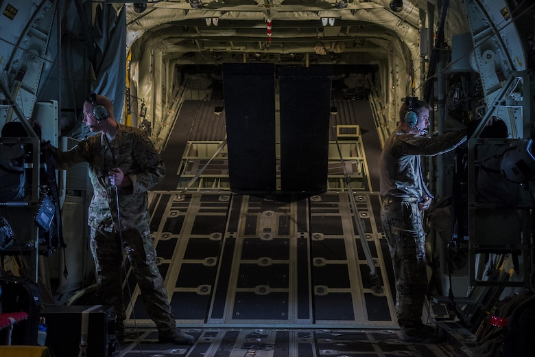 Two Airmen, assigned to the 71st Rescue Squadron at Moody Air Force Base, Ga., look out the windows of a C-130J Super Hercules during rescue and refueling training near Beja Air Base, Portugal, Oct. 23, 2015. The training was in support of Trident Juncture 2015, the largest NATO exercise conducted in the past 20 years, involving more than 35,000 troops from over 30 NATO member nations and partners. (U.S. Air Force photo/Airman 1st Class Luke Kitterman)