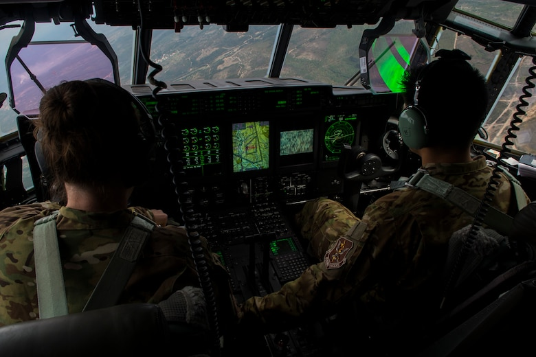 Two pilots, assigned to the 71st Rescue Squadron at Moody Air Force Base, Ga., fly a C-130J Super Hercules during rescue and refueling training near Beja Air Base, Portugal, Oct. 23, 2015. The training was in support of Trident Juncture 2015, the largest NATO exercise conducted in the past 20 years, involving more than 35,000 troops from over 30 NATO member nations and partners. (U.S. Air Force photo/Airman 1st Class Luke Kitterman)