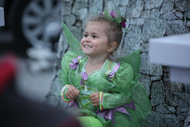 Noa, 3, smiles while receiving treats during the 3rd Annual Trunk-or-Treat event at Marine Corps Air Station Cherry Point, N.C., Oct. 26, 2015. Marine Wing Headquarters Squadron 2 and Marine Aircraft Group 14 hosted the event to increase camaraderie with the Marines and families of 2nd Marine Aircraft Wing. During the event, service members, spouses and family members were able to trick-or-treat, watch movies, get their face painted and play Halloween themed games. (U.S. Marine Corps photo by Cpl. U. B. Roberts/Released.)