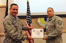 Master Sgt. Nicholas Fink, 509th Civil Engineer Squadron vehicle control, receives a Vehicle Control Officer (VCO) of the Month award at Whiteman Air Force Base, Mo., Oct. 26, 2015. Fink was the first Airman to receive the VCO of the Month award as it was recently developed to show appreciation to those who show excellence in maintaining government vehicles. (U.S. Air Force photo by Airman 1st Class Michaela R. Slanchik/Released)