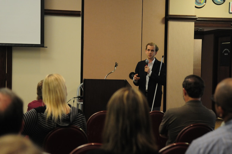 Justin Harford, a disability community advocate at FREED center for independent living, speaks to the audience during a National Disability Employment Awareness Month event Oct. 28, 2015, at Beale Air Force Base, California. The event marks the 70th year since the first observance of NDEAM, which is themed My Disability is One Part of Who I am. (U.S. Air Force photo by Staff Sgt. Zachary L. Vucic)