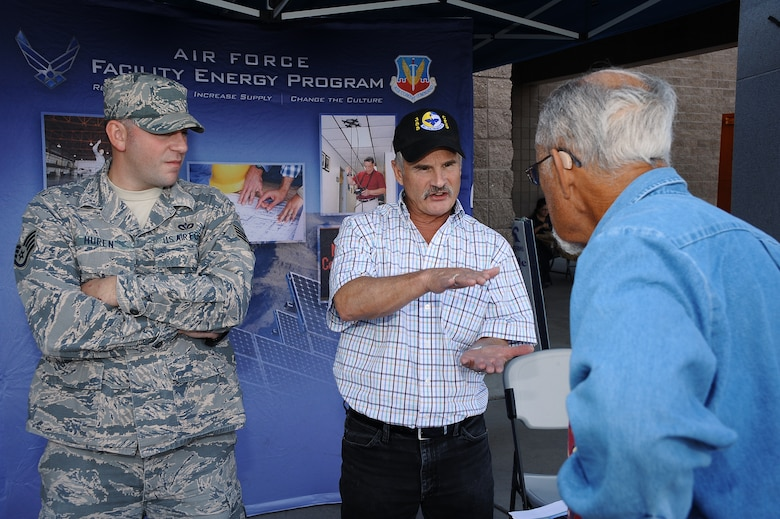 U.S. Air Force Staff Sgt. Joel Huren, 355th Civil Engineer Squadron base utility manager, and Greg Noble, 355th CES energy manager, showcase how Desert Lightning Team members save energy and resources at Davis-Monthan Air Force Base, Ariz., Oct. 28, 2015. For National Energy Day, Huren and Noble, along with other energy experts, informed Desert Lighting Team members about energy efficiency. (U.S. Air Force photo by Airman 1st Class Mya M. Crosby/Released)