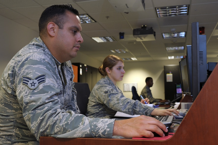 Senior Airman Benjamin Galvan and Airman 1st Class Presley Power, 148th Space Operations Squadron satellite systems operators, and Senior Airman Paul Davis, 148th SOPS terminal operator, man their respective stations for the Advanced Satellite Mission Control Subsystem, or ASMCS Oct. 29, 2015, Vandenberg Air Force Base, Calif. Galvan, Power and Davis represent the standard shift of a three person team of operators for the 148th SOPS, the first Air National Guard unit with a satellite command and control mission. (U.S. Air Force photo by Michael Peterson/Released)