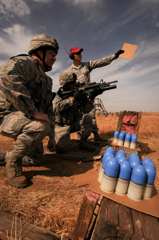 U.S.  Airmen from the 129th Rescue Wing zero their M203 grenade launchers, Beale Air Force Base, Calif., Oct. 8, 2015. Security forces is preparing for deployment later this year. (U.S. Air National Guard photo by Kim E. Ramirez/Released)
